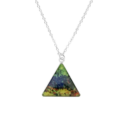 close up of triangle shaped skin cancer awareness necklace with short silver chain and shades of green blue yellow and red cell image in resin