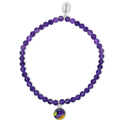 awareness stretch bracelet with dark purple amethyst stones and small round silver pendant containing lymphoma cell image under resin