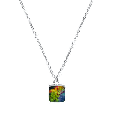 close up of square multicolor pendant chain necklace for melanoma awareness gives back to research