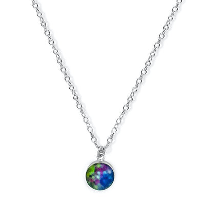 close up of colorful melanoma pendant on chain necklace for skin cancer research and awareness