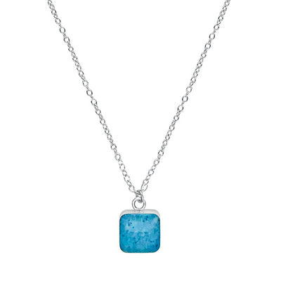 close up of square blue pendant chain necklace for multiple sclerosis awareness gives back to research
