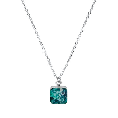 close up of square teal pendant chain necklace for ovarian cancer awareness gives back to research