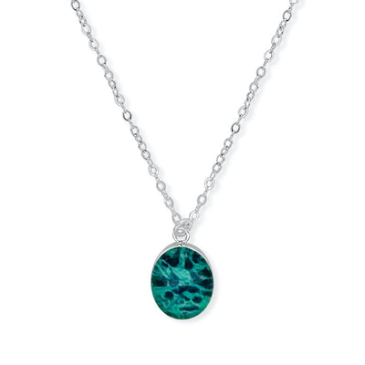 close up of teal necklace for ovarian cancer awareness and research
