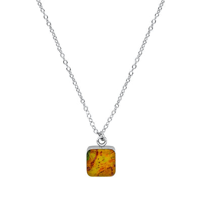 close up of square yellow, orange and red pendant chain necklace for prostate cancer awareness gives back to research