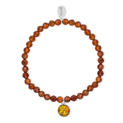 Prostate cancer awareness bracelet with orange garnet stones and round resin pendant containing histology slide image
