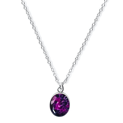 close up of purple oval pendant with synovial sarcoma histology slide under resin for awareness gives back to charity