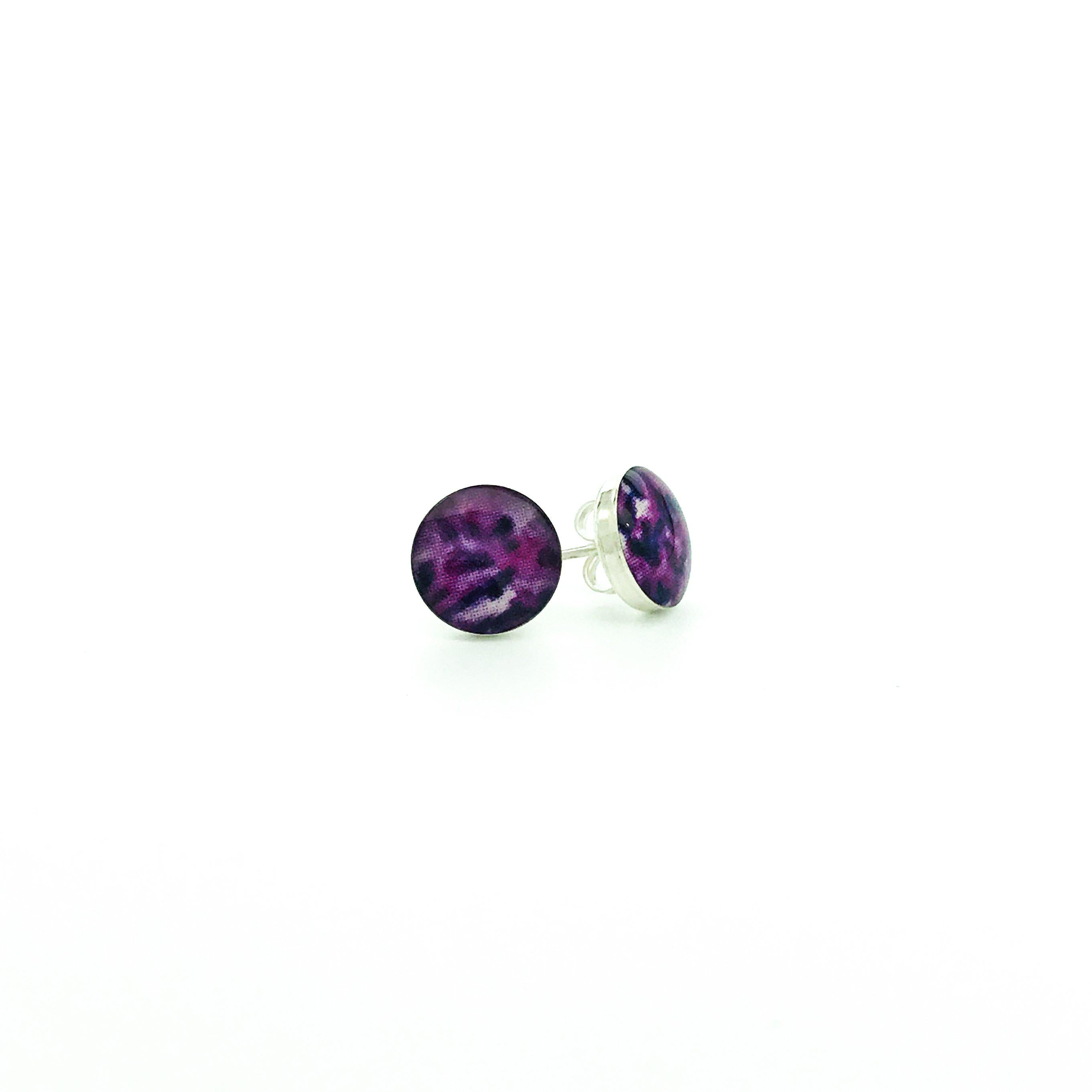 8mm round sterling silver stud earrings with purple sarcoma cell image in resin and ear nut backing
