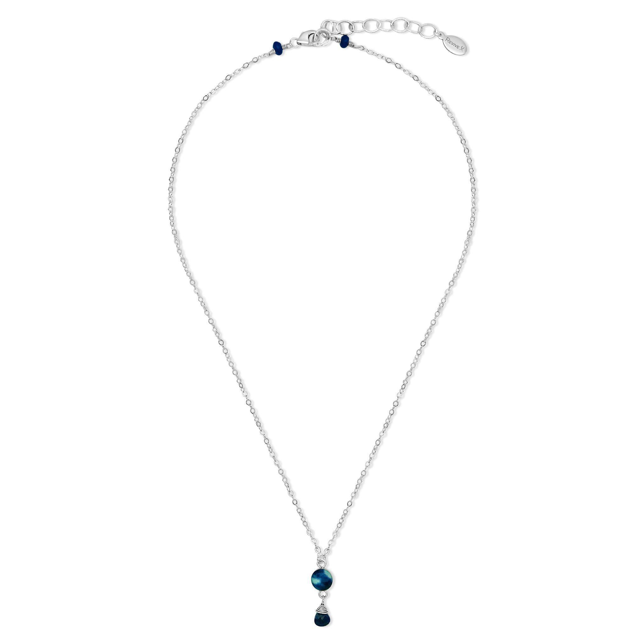 Sterling silver adjustable thin short chain with small round pendant containing a cell image of neuroblastoma under resin and a lapis stone dangle from the pendant to help fund childhood cancer research