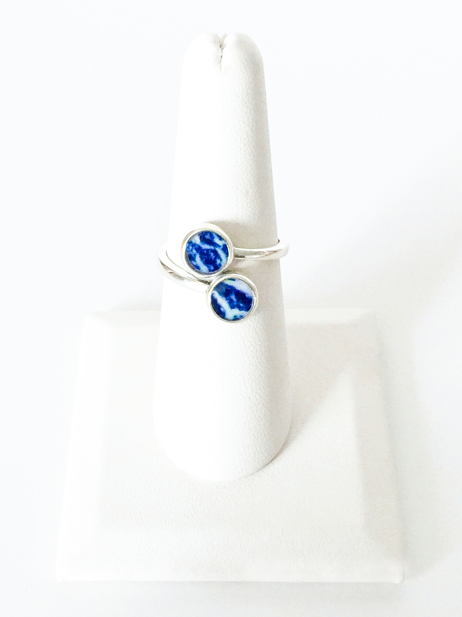 silver ring with sterling silver band and round white and blue resin stones setting ring
