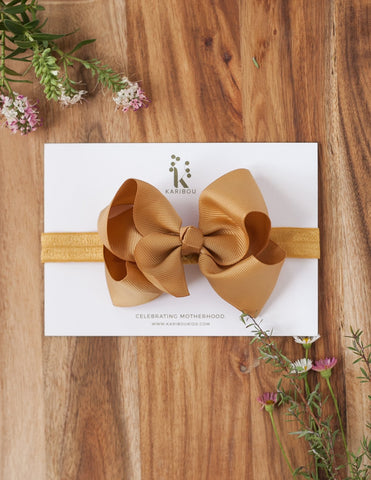 Oversized Bow Headband by Karibou