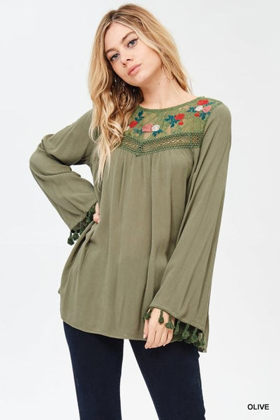 -Solid top with embroidered yoke and long sleeves with tassel fringe. Unlined. Non-sheer. Lightweigh