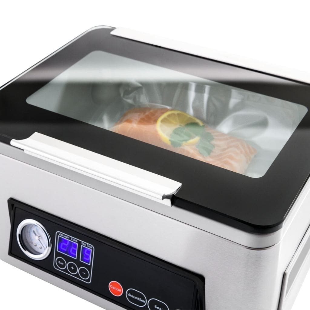 Proline D4 Vacuum Chamber Sealer Looking Through Glass Lid with Salmon Vacuum Sealing