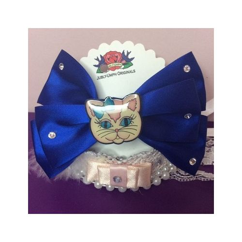 Australian online store JATOE still sells Jubly Umph hair bows including this blue satin cat hair bow! www.jatoe.com.au