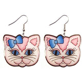 Australia's Jubly Umph has created the most gorgeous Dangle Kitty Hook earrings in blue and pink. JATOE sells Jubly Umph earrings.  www.jatoe.com.au
