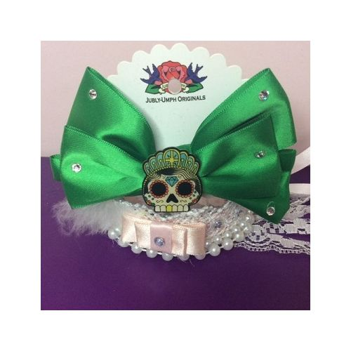 Australian online store JATOE still sells Jubly Umph hair bows including this green satin skull hair bow! www.jatoe.com.au
