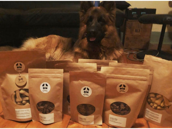 Dog with lots of bags of Bonza Dog Treats