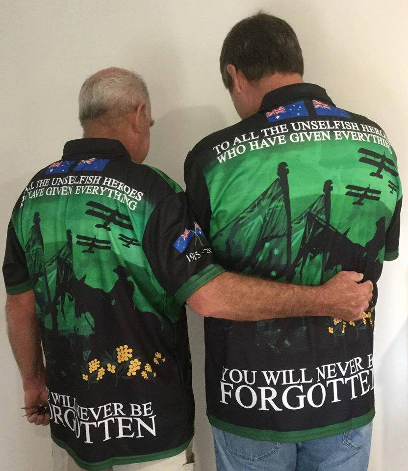 People wearing Centenary Significance Classics Green Polo Shirt, Back View
