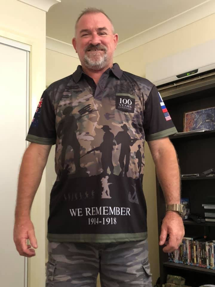 A Person wearing The Spirit Lives On Centenary Camo Polo, Front View