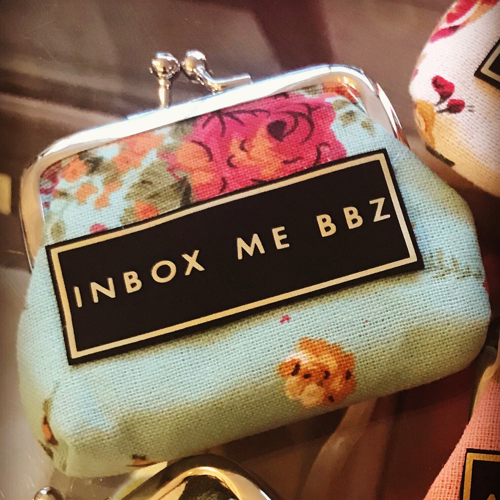 'INBOX ME BBZ' coin purse. Please note fabric design will vary.