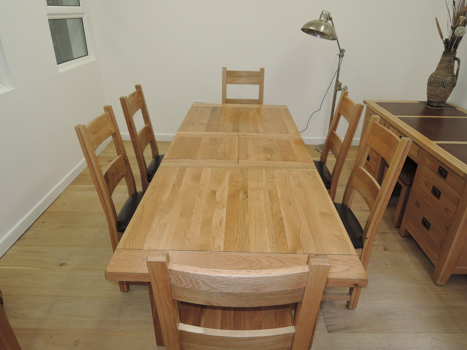 VANCOUVER OAK 9.9m 9.9m EXTENDING TABLE AND 9 SOLID OAK OR LEATHER CHAIRS  NB009