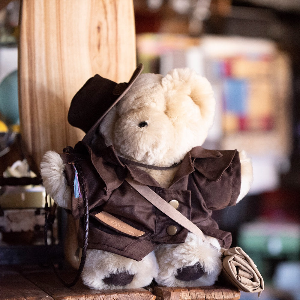 Tambo Teddy wearing oilskin jacket and outback hat