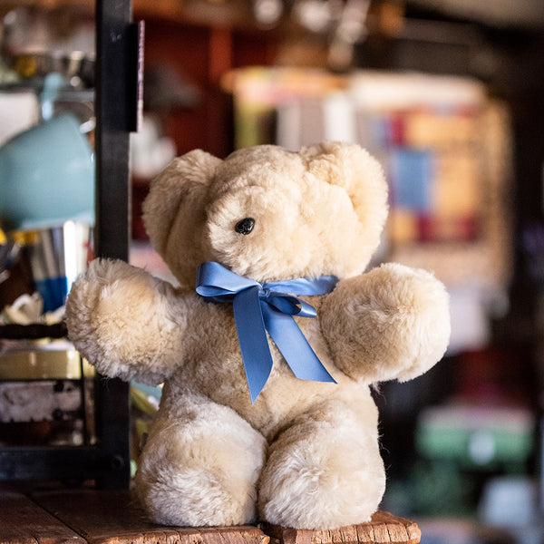 Tambo Teddy Bear with Blue ribbon around neck