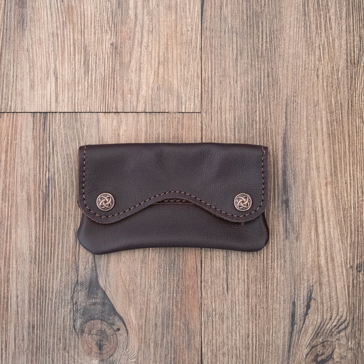 Leather tobacco pouch with 2 clips.