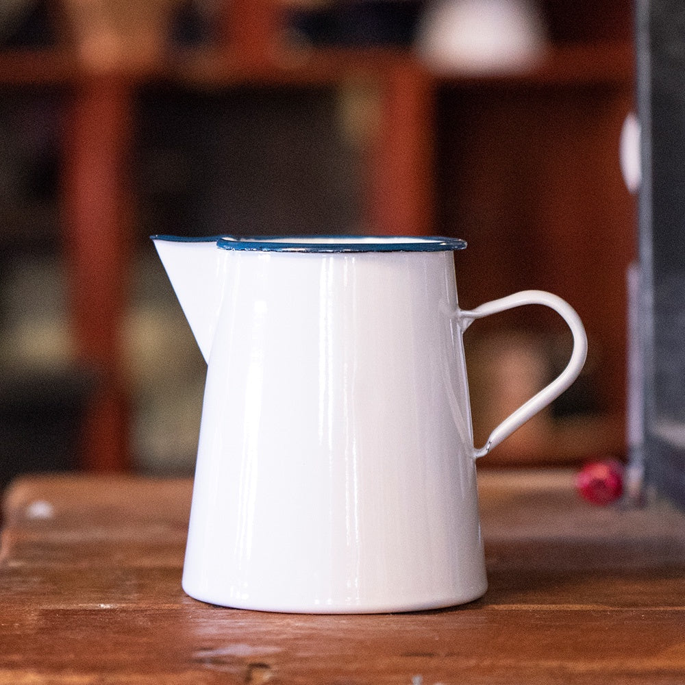 White enamel pitcher jug with blue trim