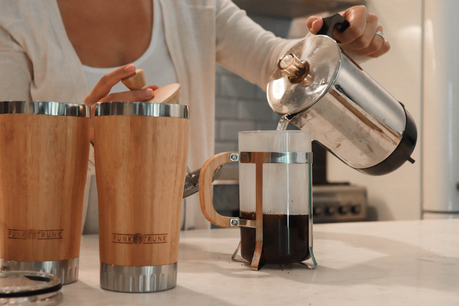 Pouring hot water to your Funk Trunk Bamboo French Press to start your day