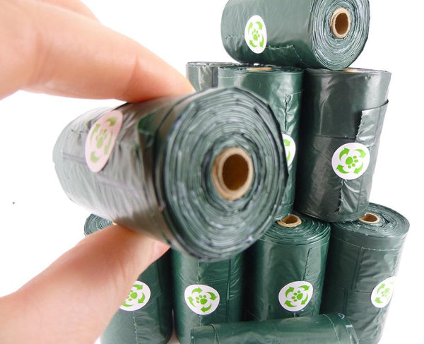bio degradable dog poop bags with handles on a roll