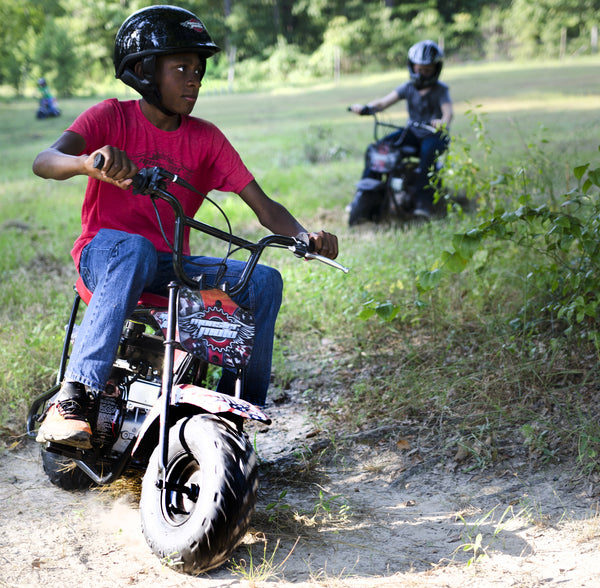 80cc Mini Bike - AMERICAN FLAG boy riding bike
