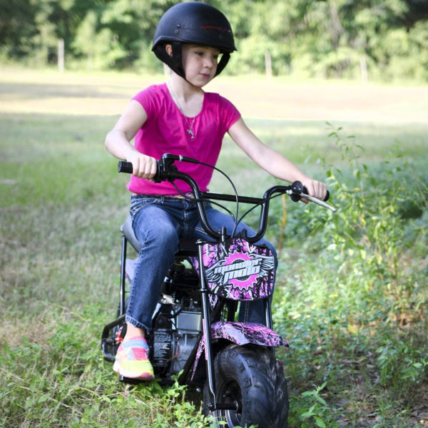 muddy girl mini bike - girl riding in a field