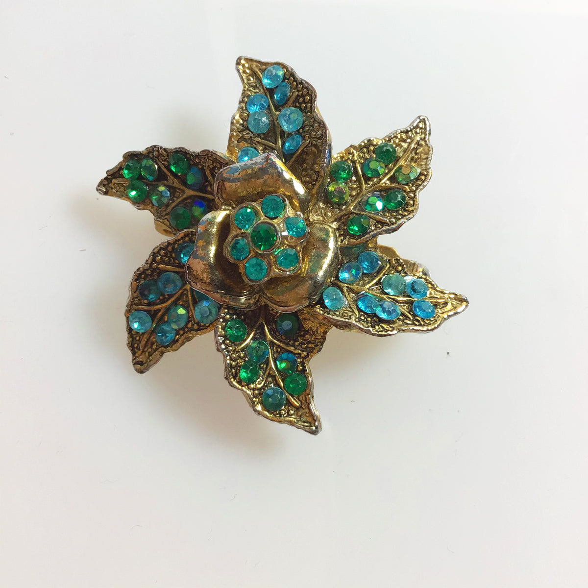 Green and blue rhinestone floral star brooch