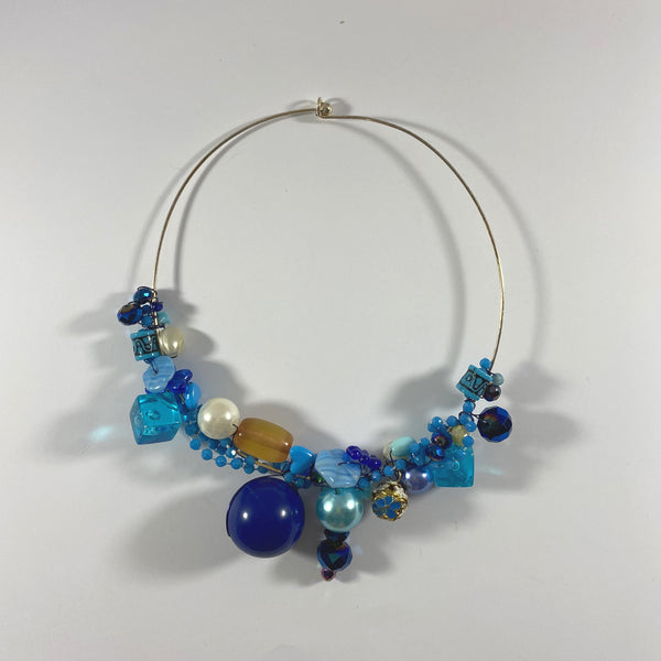 Blue wire wrapped choker necklace.