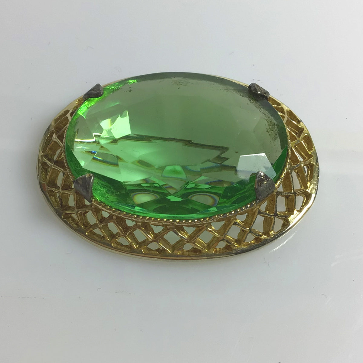 Gold plated and faux peridot vintage brooch