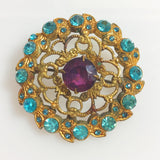 Vintage Czech filigree brooch with purple and blue crystals