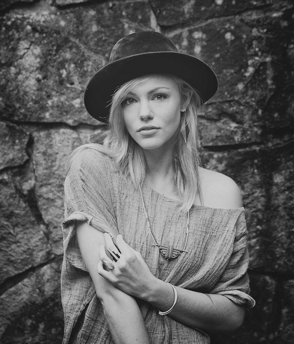 Black and white photograph of model wearing betsy and iya jewelry, dressed in a modern hipster style.