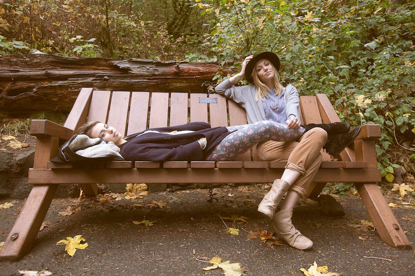 Two models sitting on a bench on the Multnomah Falls trail to take a break.