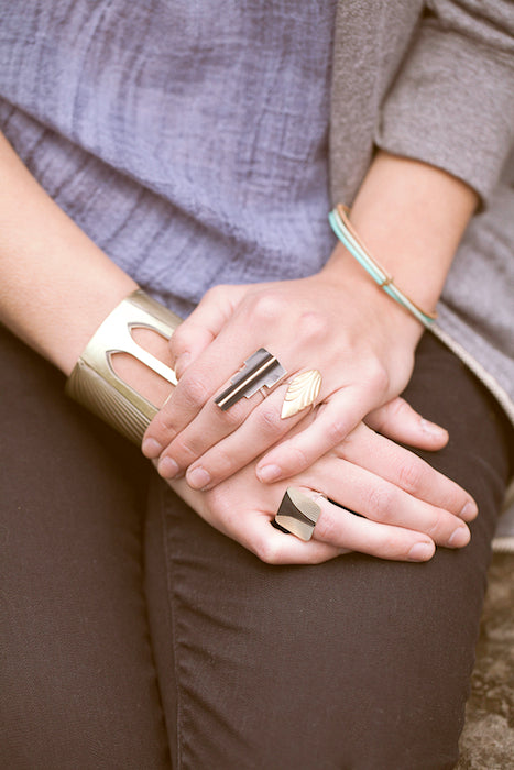 Close up of the bridge collection jewelry on hands in the lap.