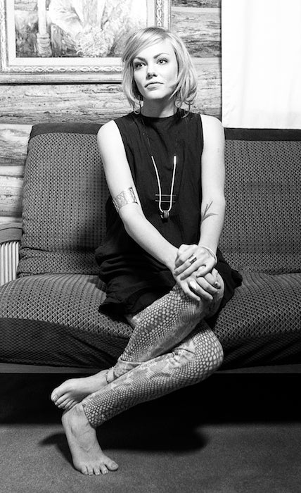 Beautiful model on a cabin couch.