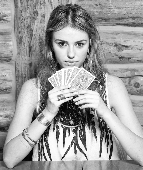 Intense model stare while playing cards.