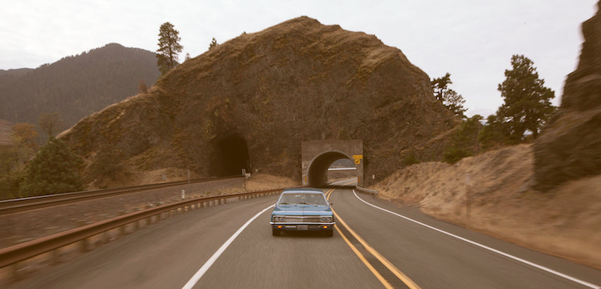Photograph of an old car on a road trip through the Columbia Gorge.
