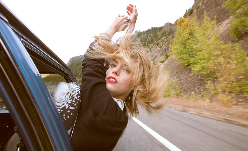Girl with her hair blowing in the wind.