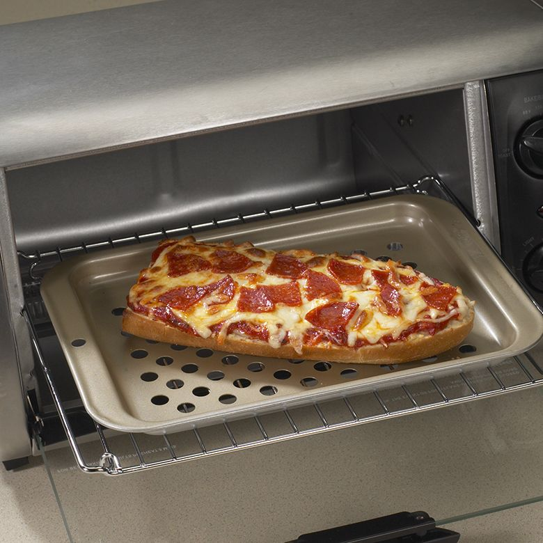 Nordic Ware 47010 Crisping Sheet in toaster oven with pizza
