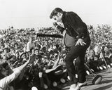 Elvis Presley (on stage with fans) Photo