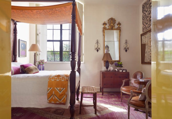 Amelia Handegan designed this room with an American poster bed with an antique Fortuny panel