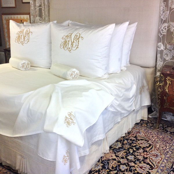 Pillow shams become decorative elements when treated to monograms, these in our Pandora Style.