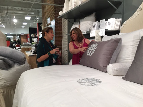 Toma Clark Haines shows off her custom monogrammed bedding.