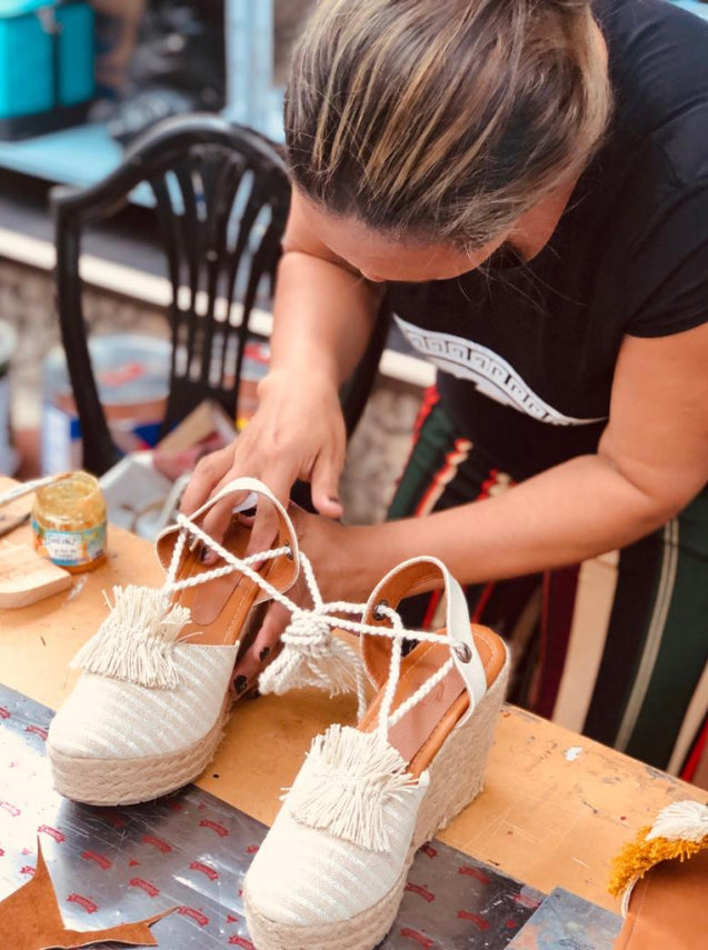 Crafting a handmade shoe.
