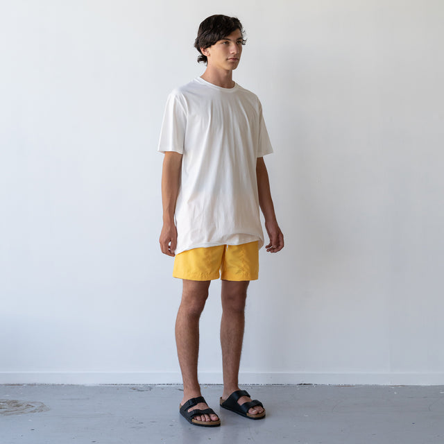 THE STABLE SWIM SHORT / MUSTARD YELLO